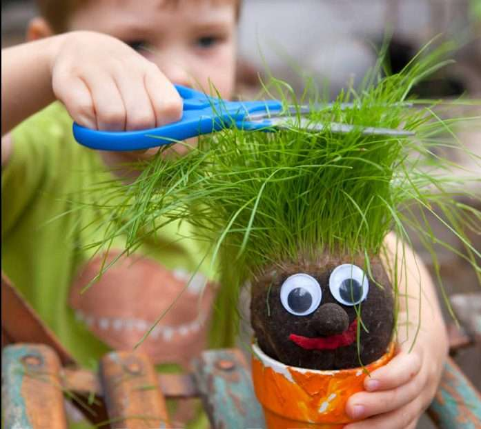 Kid playing with grass head